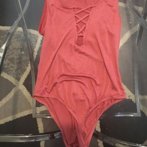 Salmon colored body suit